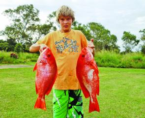 Daniel Danowski with a pair of saddle-tail sea perch.