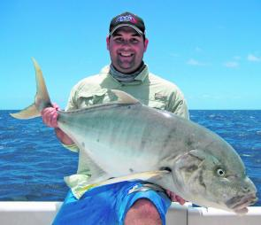 Steve Kelly with a donkey of a golden trevally micro jigged off a 3ft rise in the middle of Hervey Bay.