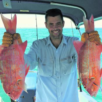 Alan Purvis with a pair of Chinaman fish, taken off a deep reef north of Fraser Island. These fish look good but are not for the table.