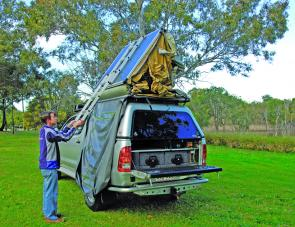 A little pull on the ladder will be rewarded with the sight of the tent coming over and locking into position for use.