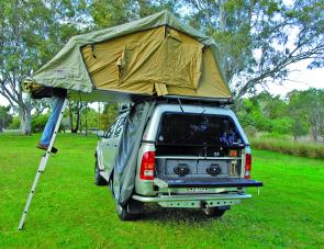 Once the tent is stretched into shape telescopic bows can be extended to keep it rigid.