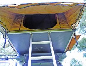 The car tent's front awning provides plenty of weather protection.