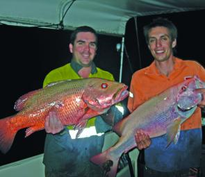 Darren Oar and Matthew Pattinson show off their bumper reef jack and great large-mouth nannygai, caught while bait fishing on a recent over night reef trip.