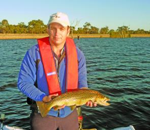 The author shows how it is done with a marvellous 2kg brown trout from Lake Fyans.