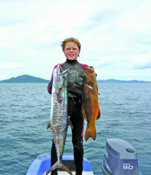 Tim Shailer, 12yo, with a decent Spanish and trout that he speared. Despite his young age, Tim is a great diver and can already reach 15m deep.