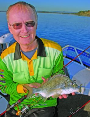 Peter Cashman opens his account with a 32cm F/L fish off a sunken rock bar.