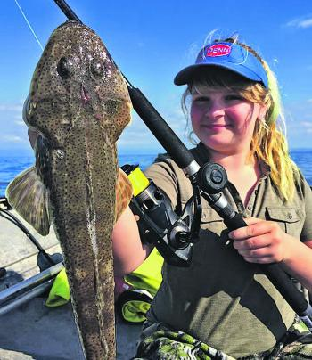 Clea with an awesome summer flathead that's sure to be tasty.