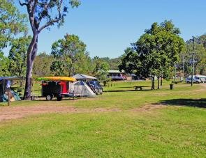 The general layout of these camp grounds lends itself to first- in best -dressed style of camping. That building in the background is the camp office and kiosk.