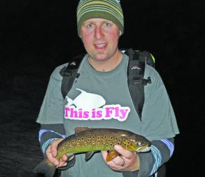 The author is blinded by the light as he shows a healthy brown trout caught in the hours of darkness.