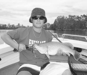 Young Zac Manning with his new personal best Murray cod, a 57cm version taken on an Oar-Gee lure.