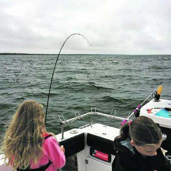 Mia sticking it to a big Westernport whiting while her friend Trinity gets the hook out of another.