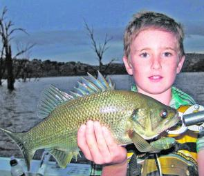 Tyler Colley from Oberon with his first bass, caught on a surface lure.