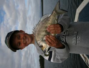 Young Brett Lyons, 8, with a super bream he captured the first time he used soft plastics.
