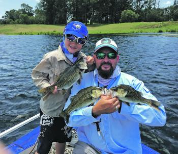 Mark and Dane Corbin with a few of the bass they caught recently on Tiemco Soft Shells.
