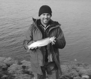 Shane Jeffrey with a brown trout of 750g that he caught on a Hamils Killer fly in Newlyn Reservoir.
