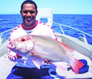Ty Willams from the North Queensland Cowboys with a scarlet sea perch onboard a One More Cast Fishing Adventures charter.