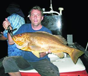 Steve Pearman with a trophy red off Townsville.