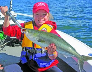 Olivia Kerr with a salmon caught around Moon Island. Take a kid fishing and watch the smiles.