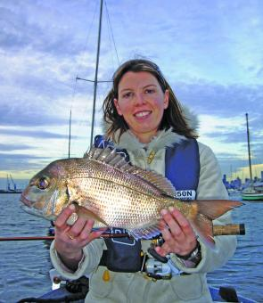 Katrina Paton with a pinkie snapper taken from the moored boats at Williamstown on a Berkley Gulp Sandworm.