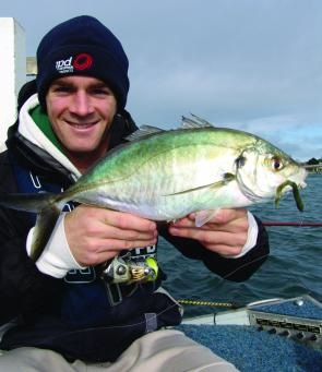 Aaron Hassett with a trevally taken from the Queenscliff Marina on a Berkley Gulp Turtleback Worm. Marina fishing requires a combination of a stealthy approach, accurate casting and finesse presentation.