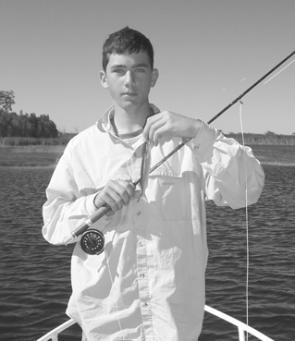 The author's eldest son James, with his first fly-caught fish. An important milestone in any young angler's career.