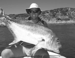 Cory Munns with a Popper caught trevally near The Keppels.