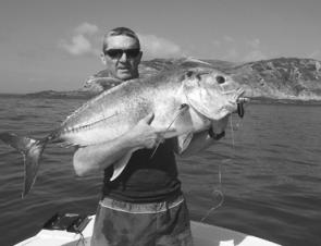 Bill Robertson scored this trevally on a gold Popper at Keppel.