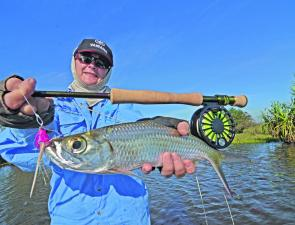Tarpon or ox-eye herring have hard mouths and are notoriously difficult to keep on a hook. Strip-striking firmly while fly fishing allowed Jo to solidly pin this one, despite the monofilament loop weed guard on her Pink Thing fly.