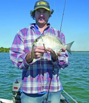 "Andy with a nice bream taken on a 6"" Sandworm camo."