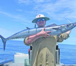 Conor Lynch and a 12kg wahoo onboard Triton IV with SQCS.