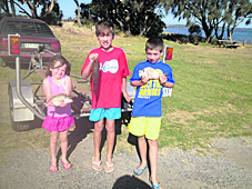 These youngsters look happy with their fish caught off Mahers Landing at Anderson Inlet.