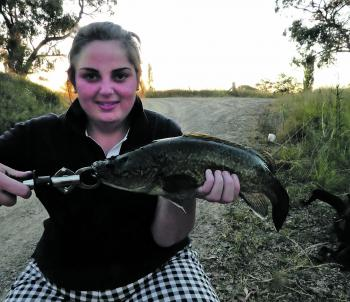 Hayley McDonald shows that you don't need to be remote to catch a fish. This one came from the side of the road.
