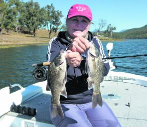 This pair of Maroon bass taken by Denise Kampe are fairly representative of the fish the fly angler will enjoy catching this year.
