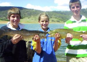 Canberra youngsters Michael Tye, Stacey Korda and Michael Korda with some prize browns caught at Lake Jindabyne.