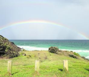 A rainbow forms over The Gap.