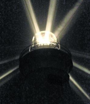 Smokey Cape lighthouse in action at night.