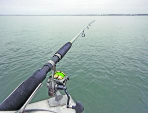 Keeping rods level with the water line allows the fish to take line from the reel without loading the rod eliminating any resistance which could have the fish drop the bait.