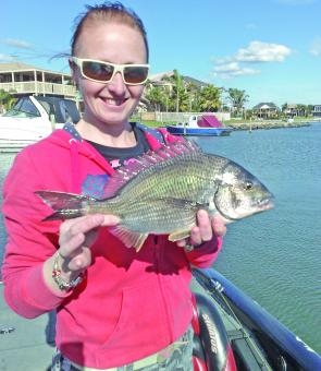 Jodi Peck holds a bream caught by the author in the canals at Patterson Lakes.