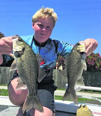 Mackenzie Luck with a couple of bass caught on a Bassman Spinnerbait and Megabass Siglett.