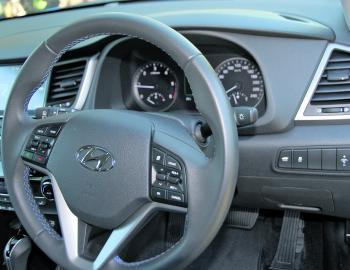 A host of controls are centred around the Tucson's wheel.