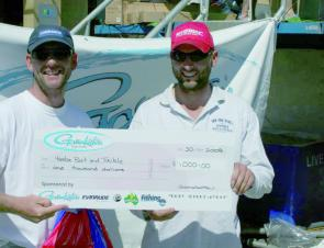 Team Yamba Bait and Tackle with their winning check for $1000.