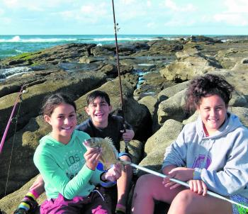 The Kia fishing team youngsters enjoy eating bream for tea!