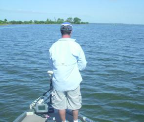 Robert Harvey searching the shallows for bream. This is great sport when you can see the fish and cast lures to them.