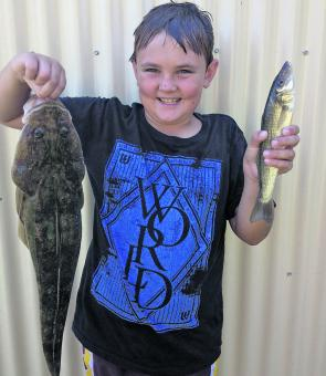 Young Jack Bechly is a newcomer to fishing, and by the look of his smile he won't be giving it up any time soon.