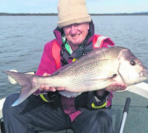 Tom Mclean with a howler catch-and-release 79cm red from the Basin.