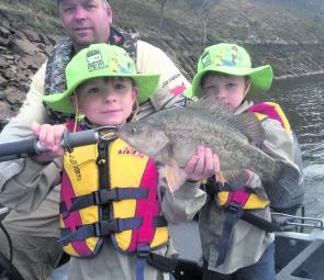 Angus and Hunter Behnke of Wagga picked up this golden perch trolling 50mm AC Slim Invaders along a deep rock wall with their dad Andrew at Burrinjuck Dam.