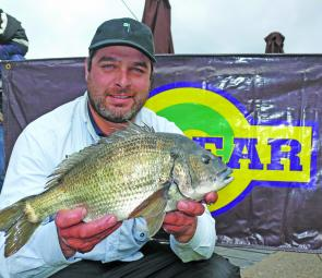 Damien Domagala from Team Doma displays the 1.46kg Eco-Gear Big Bream hit caught in Saturday's first session.