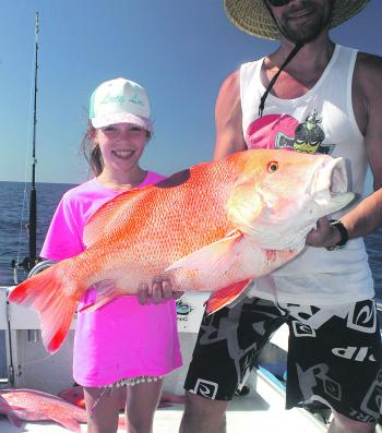 It was a father and daughter team effort to get this nice red emperor to the boat.