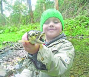 Lochie holds up a trout that took a Gulp Power Minnow in Traralgon Creek on opening weekend.