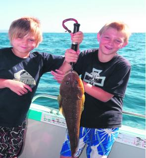 Kids just love fishing and when a big flathead comes aboard, it's smiles all around.